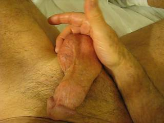 I'd like tosuck on his balls as he rubs his cock