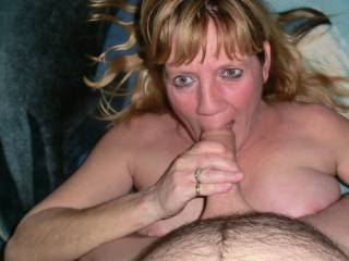 Wife sucking my cock while doing a cam show
