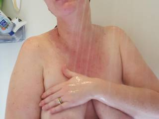 Caressing my milk filled breasts