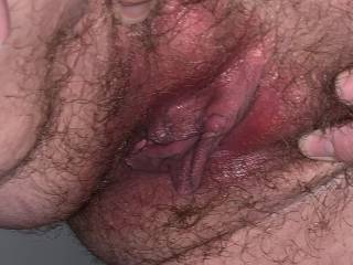 Kiki spreading her hairy little pussy again. She likes when I spread her pussy by pulling the hair on her fat lips.