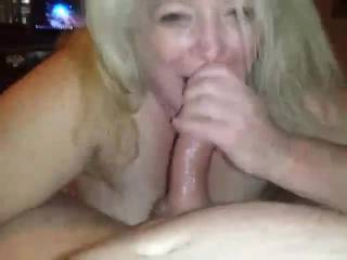 giving her boyfriend a good blowjob while she rests for few then we both give him one at same time.