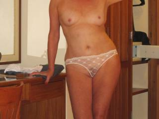 Soooooooo Hot n' Sexy.  Love the teasing see through white panties.  Love to pull them off so sensously and seduce you right there on the desk!!