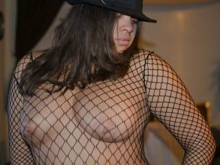 Love it all, the fishnet, hat, and facial expression. Your about to give some orders.
