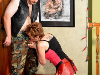 Mistress Malicia sucks Brett off in her upstairs dungeon, getting him hard to fuck her.