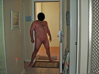 Hubby posing in the nude at our condo while on our summer 2008 beach vacation.  There was a lot of female activity outside in the hallway...I dared hubby to open the door and take a pic at the risk of being seen!