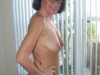 We had a guy mowing our lawns and I dared Fran to let me take a pic of her in front of the window with the curtains half open. Sadly the pics I got with him in the background were blurred. She gets horny and excited playing like this.