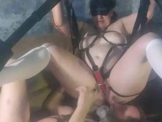 Bound in a leather harness on our sex swing blindfolded as I take her toy and star using it on her.