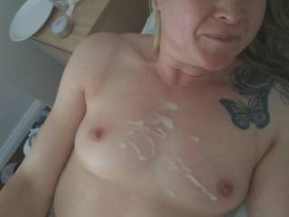 Just finished blowing my load all over her tits. She looks so happy and content
