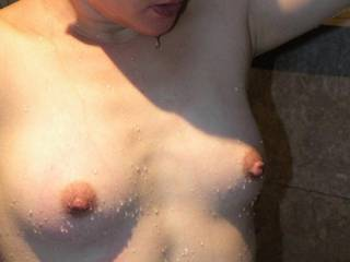 one of my fave pics. What do u think of my wife wet tiny tits?