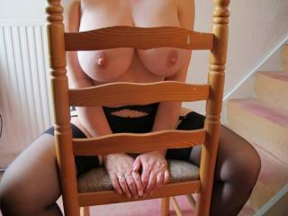So fucking HOT! Press your huge tits into the back of the chair, and as your soft breasts are smushed through the opening in the middle, feel me smack my throbbing cock against your swollen nipples