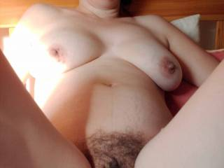 I'd love to deep fuck her hairy pussy.