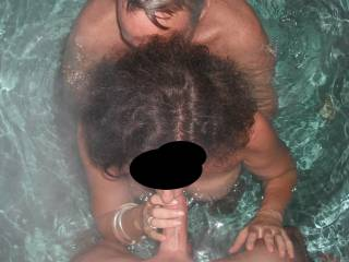 Threesome fun in the spa with our swinger friend, when he came around for a play. I am sucking my Hubby\'s lovely cock, whilst our friend plays with me.