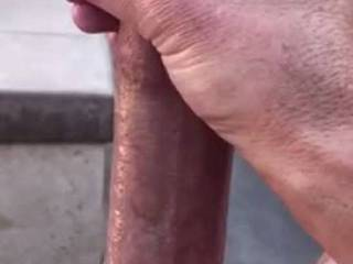Naughty boy outside where the neighbors could see him stroking his cock slowly until he cums.