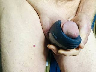 Using a vibrator on my cock this morning.