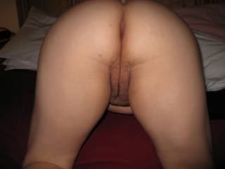 Wife bent over and showing her cunt and asshole which hole would you fuck first??