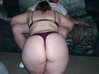 Something sexy and slutty about this picture of Lupo's wife sucking on my cock while showing off her great thick round ass!  Makes me want to fuck her every time I see it!