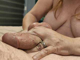 Mmm... Look how that cock shines with precum. This married woman just loves to take care of cock.