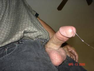 It is so fucking hot to see a string of cum hanging from a cock.  LOVE those hairy balls and it adds to the excitement seeing you dressed.  VERY nice!!