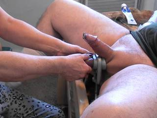 He put on ball stretcher and I inserted the penis plug. Then I put the ball clamp around the stretcher and tightened it down so those boys could not get away. Lots of fun tugging and pulling on those balls while stroking that fat cock.  Would you enjoy??