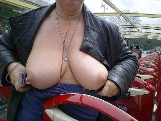 Flashing her beautiful tits on tour bus