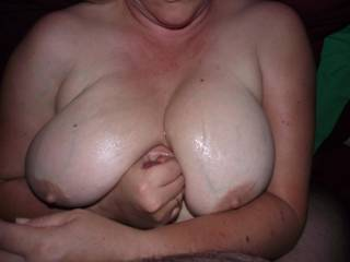 Mmmmmmm...that's hot! Love to shoot another load on her fine tits!