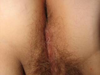 Yummy! I'd love to slide my cock in that hairy pussy after I lick her to orgasm!!