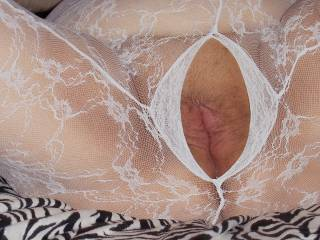 That would a dream come true. I would love to pleasure you through your open body stocking.