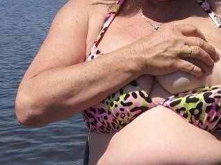 Outside on the lake trying to get started on my tan and pulling one of the girls out for a quick boob shot. Wanna see more?