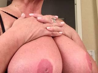 Her plump, round natural 38 D tits.  Great for titty fucking !  Who wants to try ?