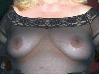 Heaven is a perfect pair of breasts in a sheer black vest, ready to play and test by rubbing against our chests! We would love to share your fun! xxx