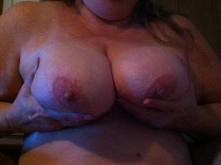 Wife squeezing tits together.  She loves cum all over them