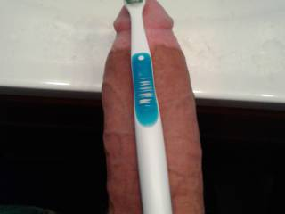 Balencing my toothbrush with my thick cock