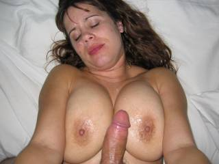 Huge load of cum all over her tits and face