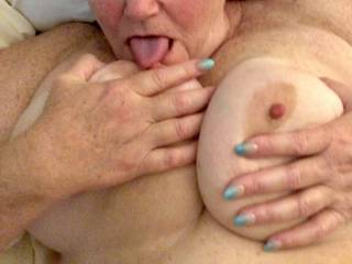 My BBW wife licking her hard nipples on her big natural tits