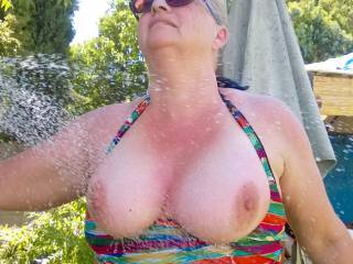 Wife cools down after watering.