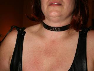 """I had to blindfold her until the temporary tattoo dried. I didn\'t want her to know which one it was. The slave collar is there just because she looks hot in a """"slave"""" collar"""
