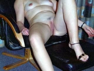 A phone-pic taken by two young guys who\'d picked me up that evening. My pussy and asshole got a nice workout on that hotel room chair before they sprayed me with cum. I went home still horny and fucked my man too !