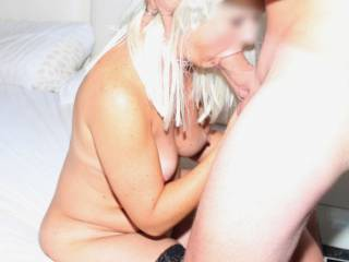 stuffing his cock into her mouth, pushing it to the back of her throat