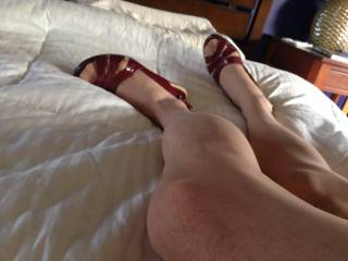 This is a picture of one of my en femme moments wearing panties, heels, slips, etc.  I find myself much more erotic and submissive, for men or women, while en femme.