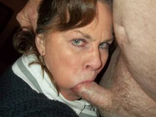 neighbor\'s wife poses for the camera with a jaw full of cock head