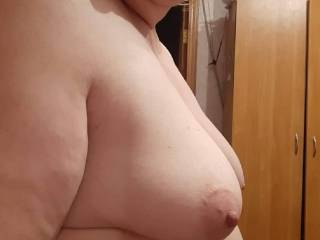 A side view of My girlfriends lovely mature tits