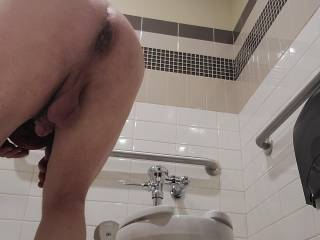 In the men\'s room at the local grocery store, ready and waiting for your cock