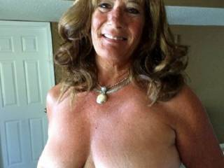 I have the most beautiful big, natural tits!  I like to go into a crowded bar and rub them up against a group of younger guys, to entice them to take me home!  I really love it when I\'m being fucked doggy-style and two guys are sucking on my tits!