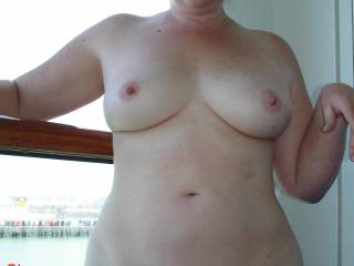 the wife strips naked on our balcony on our cruise