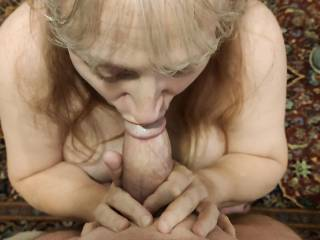 As a connoisseur of cock, I am enjoying this hard, thick one in my mouth. Hubby says I should enjoy as much cock as possible to my mouth\'s content.