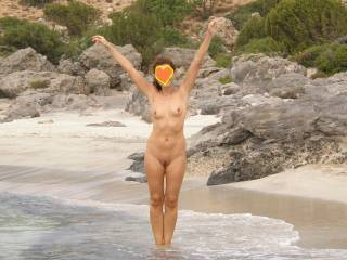 Nude in a great greek beach late this summer.Do you like her ?