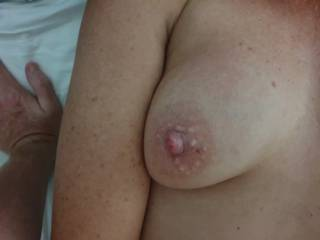 My wifes lovely boob. Suck them all day.