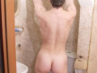 I would drop to my knees, worship it with my mouth, lick my way into your sexy crack and fuck your greedy bottom hole with my tongue before replacing it with my hard, thick cock.  I would let my hands wander over your front side, then play with your turgid nipples and clit until you came, clenching your tight puckering hole on my cock inside you, causing me to come as well.  Damn, you are a nice, tight package!
