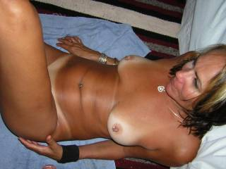 Very nice Body.  Does it hurt to have your nipples pierced and does it make them more sensitive.