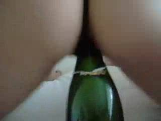 She has a hot ass..and great oral skills, wow! I would love to be fucking her instead of that bottle!!
